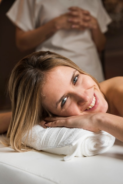 Portrait of a happy young woman at spa Free Photo