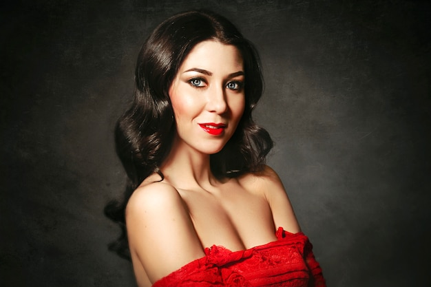 Portrait of the ideal woman in red dress. fashion Premium Photo