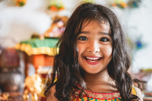 Portrait of indian female girl wearing sari dress - southern asian child having fun smiling - childhood, different cultures and lifestyle concept Premium Photo