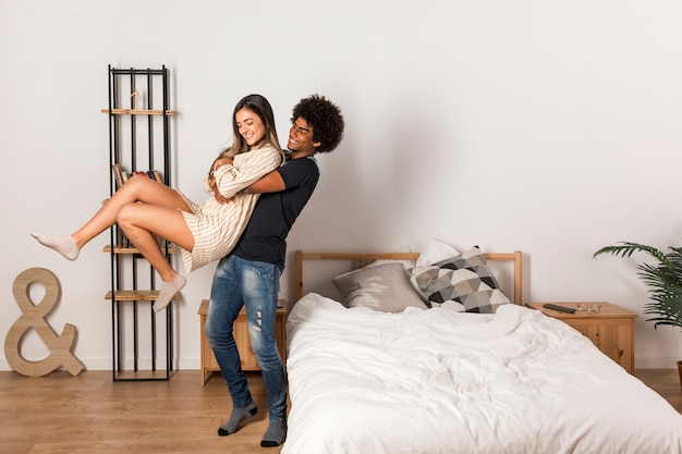 Portrait of interracial couple at home Free Photo