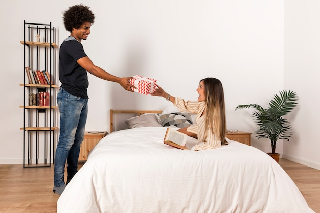 Portrait of interracial couple with present Free Photo