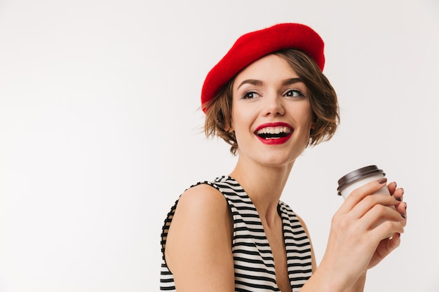 Portrait of a laughing woman wearing red beret Premium Photo