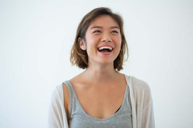 Portrait of laughing young asian woman Free Photo