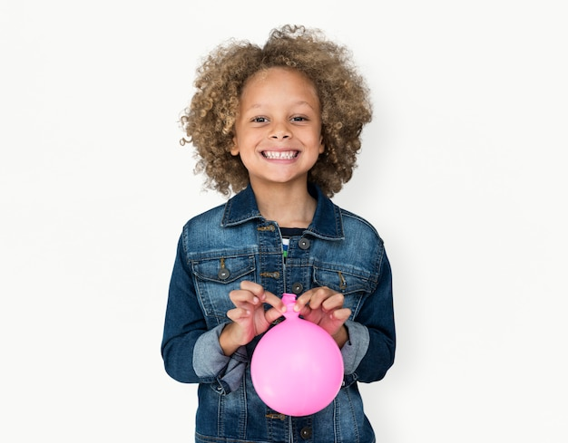 Portrait of a little african descent boy with a balloon isolated Premium Photo