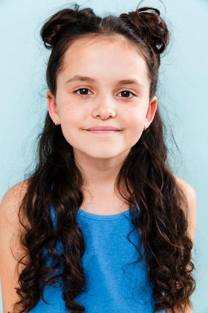 Portrait little girl on blue background Free Photo