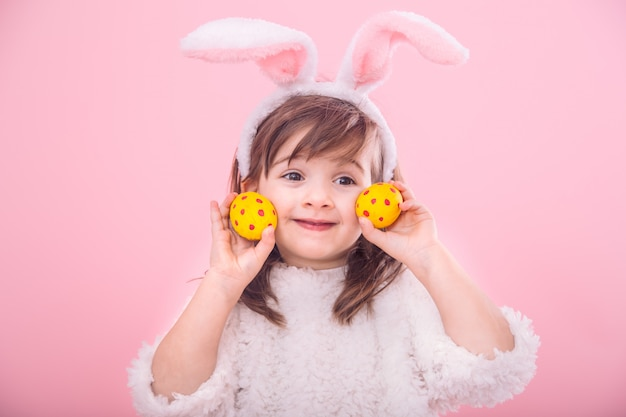 Portrait of a little girl with bunny ears w easter eggs Free Photo