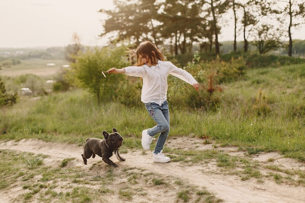 Portrait of a little girl with her beautiful dog Free Photo