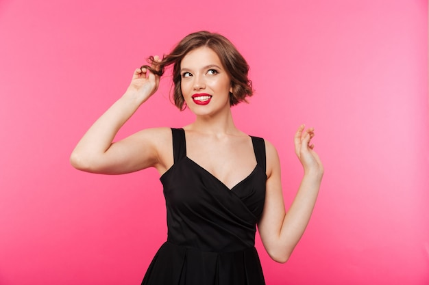 Portrait of a lovely girl dressed in black dress Free Photo