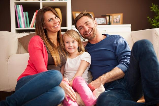 Portrait of loving family in living room Free Photo