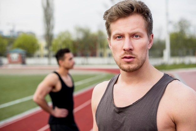 Portrait of a male athlete looking at camera Free Photo