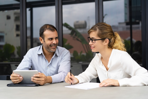 Portrait of male and female colleagues communicating in office Free Photo