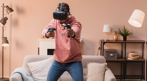 Portrait male playing with virtual headset Free Photo