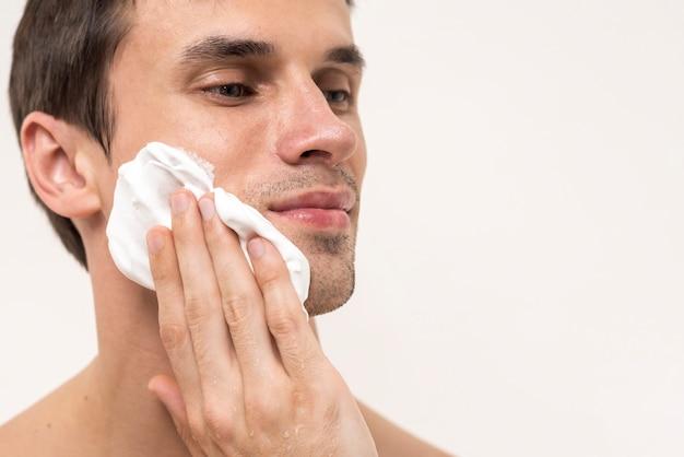 Portrait of a man applying shaving foam Free Photo