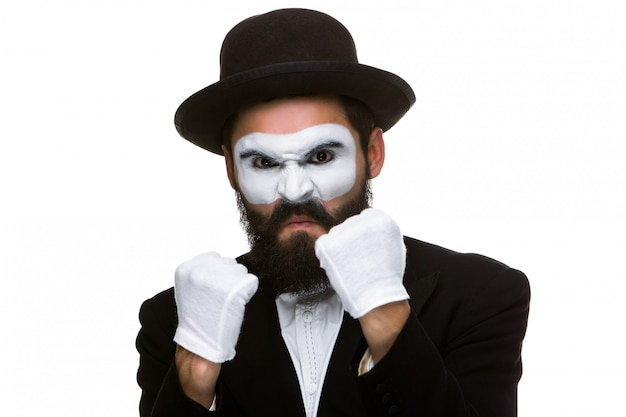 Portrait of a man boxing in makeup mime Free Photo