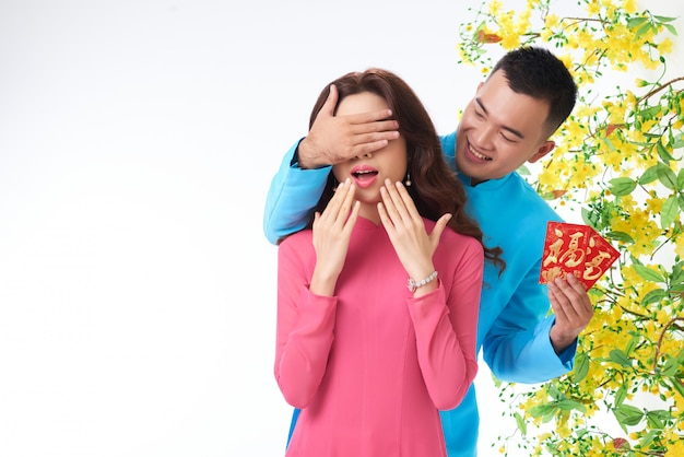 Portrait of man making spring festival surprise to his spouse Free Photo