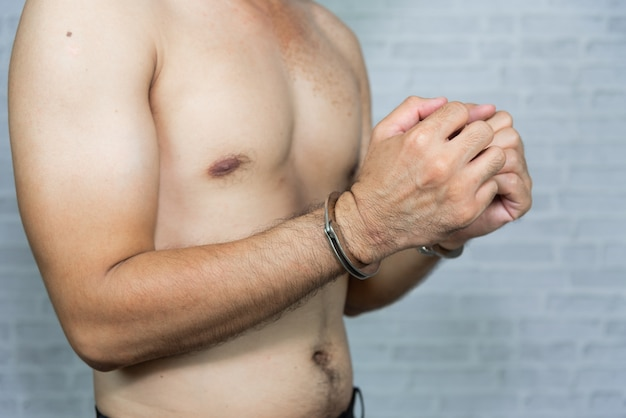 Portrait of a man prisoner with handcuff Premium Photo