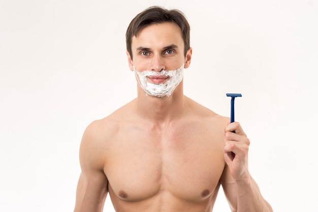 Portrait of a man ready to shave Free Photo