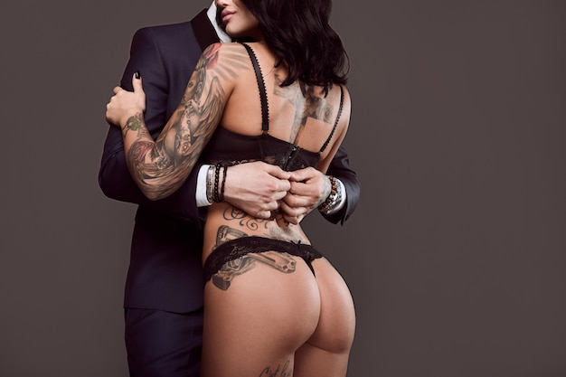 Premium Photo | Portrait of a man in suit and sexy girl