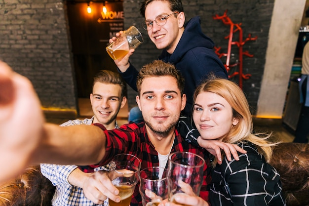 Portrait of a man taking selfie on mobile phone with his friend Free Photo