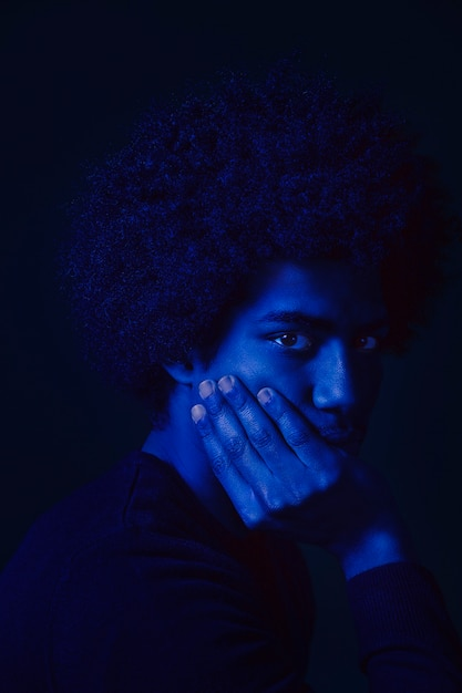 Portrait of a man with blue light Free Photo