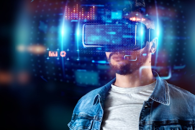 Portrait of a man with glasses of virtual reality, vr, interacts with a virtual screen. Premium Photo