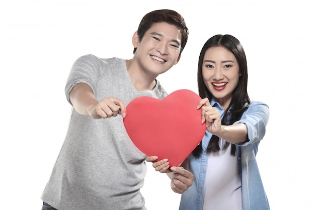 Portrait of man and woman holding red heart Premium Photo