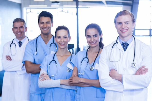 Portrait of medical team standing with arms crossed in hospital Premium Photo