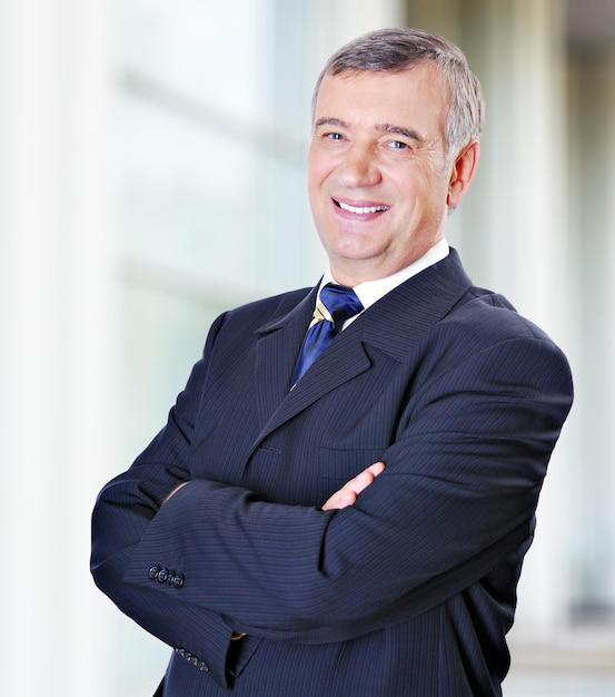 Portrait of middle-aged businessman in suit Free Photo