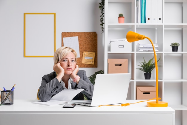 Portrait of middle aged businesswoman in office Free Photo