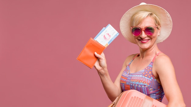 Portrait of middle aged woman going on summer vacation Free Photo
