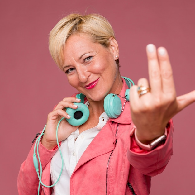 Portrait of middle aged woman with headphones Free Photo