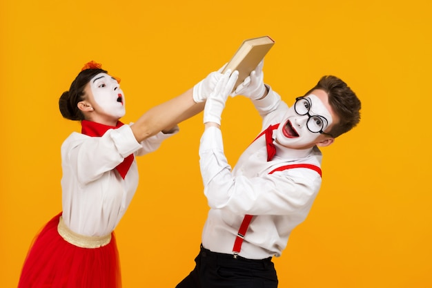 Portrait of mime couple artist with book Premium Photo