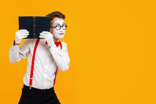 Portrait of mime man artist with book Premium Photo
