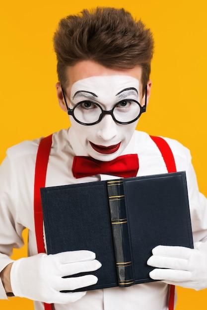 Portrait of mime man artist with book Premium Photo