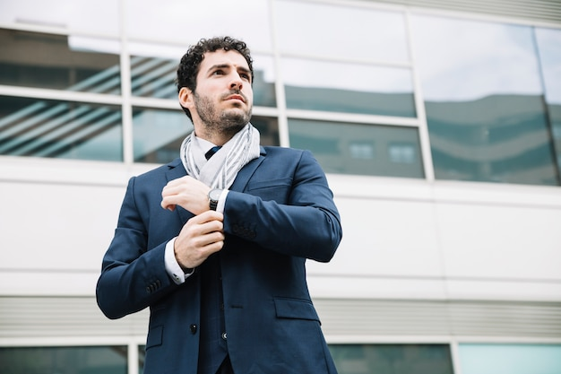 Portrait of modern businessman in front of building Free Photo