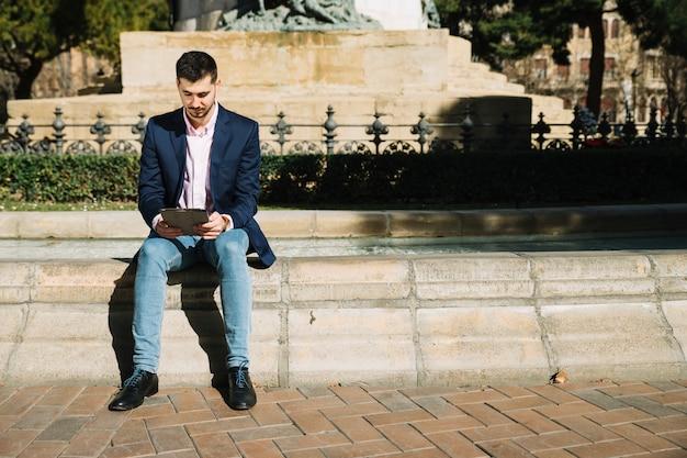 Portrait of modern businessman outdoors Free Photo
