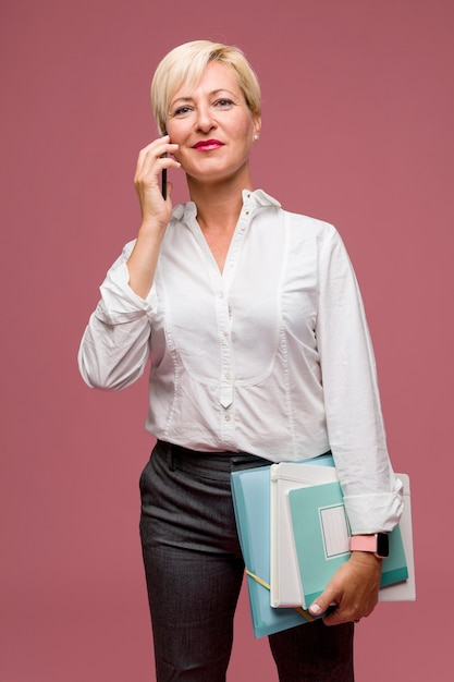 Portrait of modern businesswoman standing Free Photo