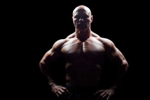 Portrait of muscular man with hands on hip Premium Photo