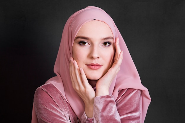 Portrait of muslim woman posing on black background Free Photo