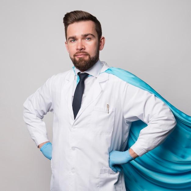 Portrait of nurse wearing hero cape Free Photo