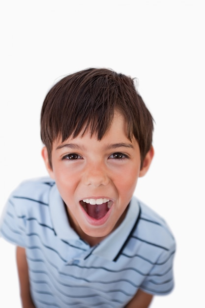 portrait of a boy screaming at the viewer photo premium download