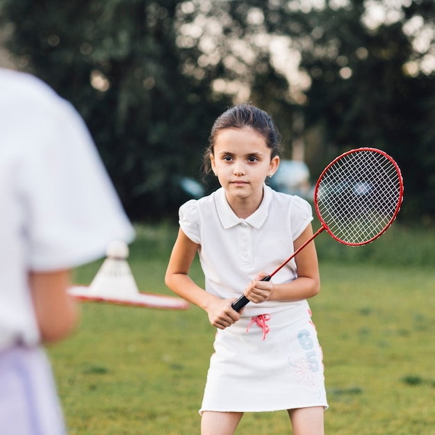 Portrait of a cute girl playing badminton Free Photo