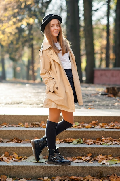 Portrait Of A Cute Teen Girl In Autumn Park Premium Photo