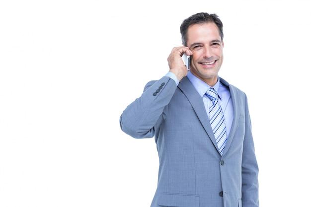 白い電話機で成功したビジネスマンの肖像 Premium写真