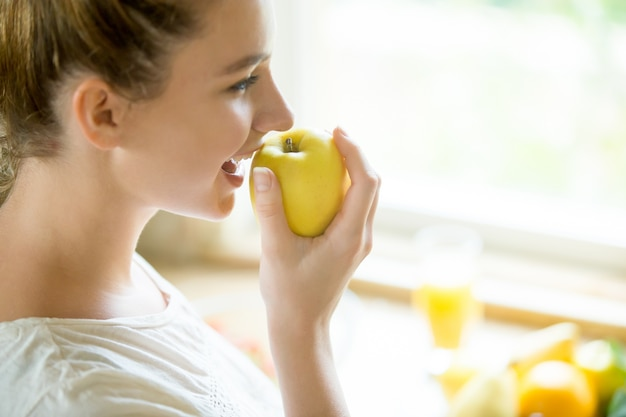 Portrait of an attractive woman eating an apple 1163 2008