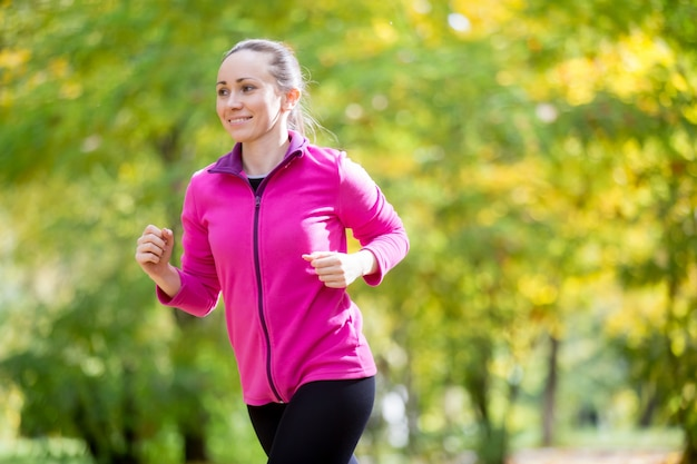 Portrait of an attractive woman jogging Free Photo
