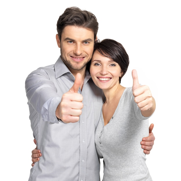 Портрет счастливой пары с большими пальцами руки вверх знак Бесплатные Фотографии