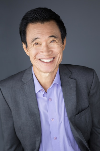 Portrait Of Happy Middle Aged Asian Businessman Photo Free Download