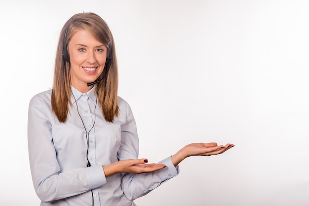 Portrait of happy smiling cheerful young support phone operator Free Photo