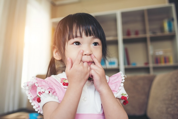 Portrait Of Little Asian Girl Playing In Her Home Free Photo
